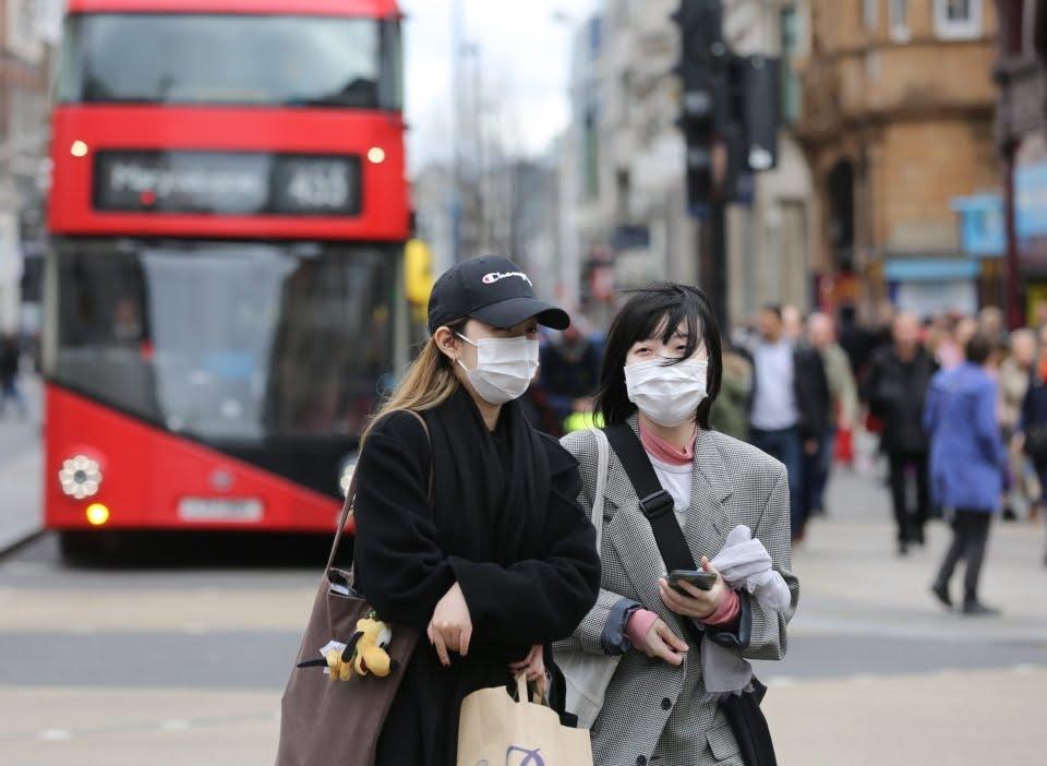 People wearing face masks in London amid the coronavirus outbreak