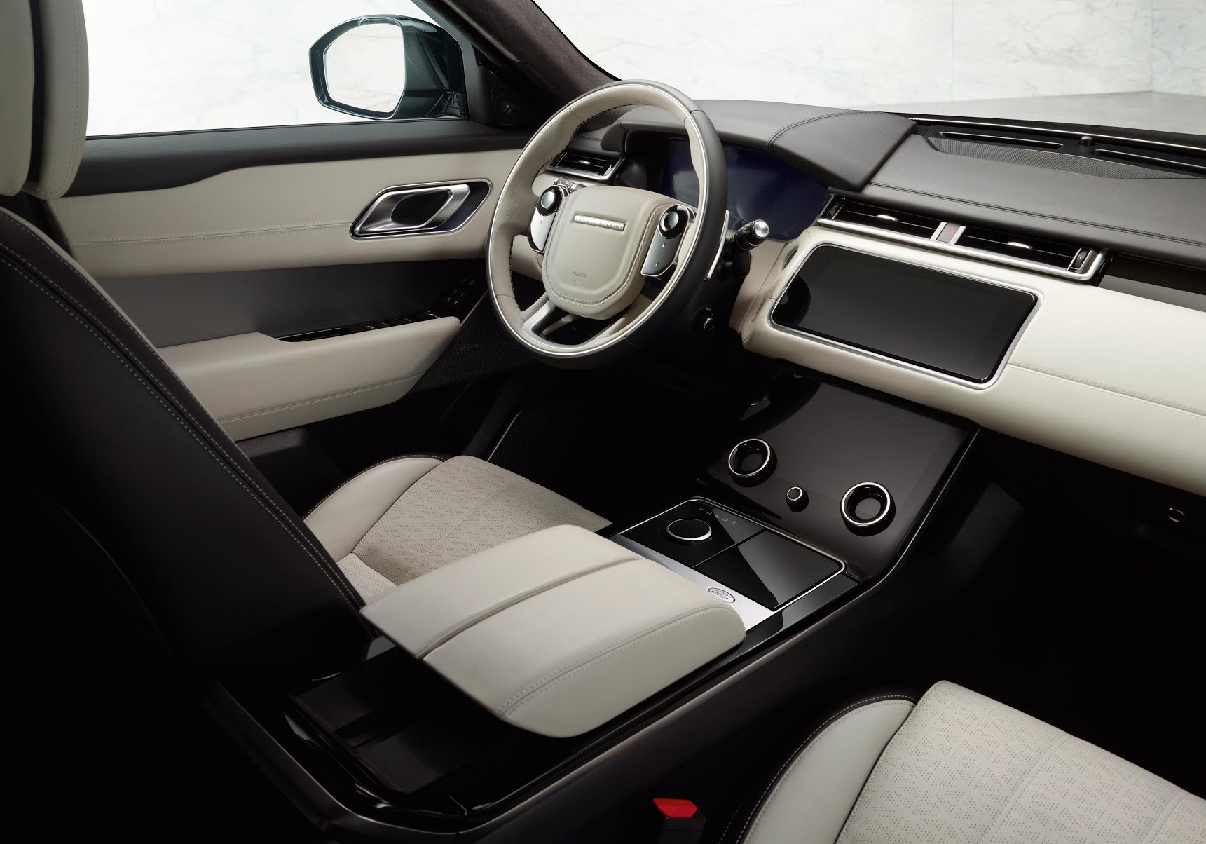 The car's interior includes two 10'' high definition touchscreens
