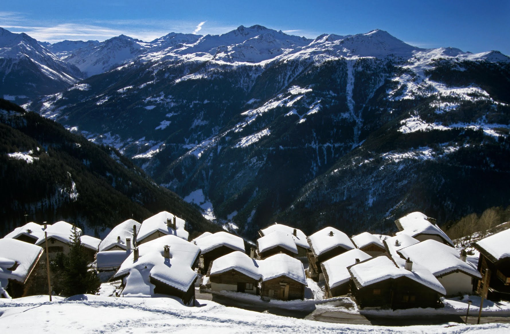 Snow covered house roofs of the mountain village Vieux Chandolin, Switzerland